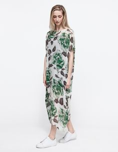 Long dress with flower pattern work casually with white sneakers
