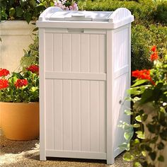 Paneled Outdoor Trash Hideaway with latching lid. This looks great on a deck or patio. Uses 30-33 gallon garbage bags. I love how this doesn't even look like a trash bin.