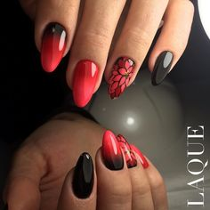 Not sure about the flower accent nail, I think I just like the black and red w/all black accent nail.