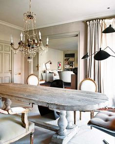 The juxtaposition of the glamorous chandelier with the rustic trestle table is too perfect for words.