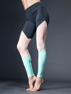 """Colorful, functional, and totally envy-able … these leggings are a total triple-threat.  With three bold colors stacked on top of each other, these leggings make a statement and that statement is """"sexy as hell."""