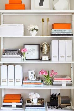 Bookcase styling with orange accents