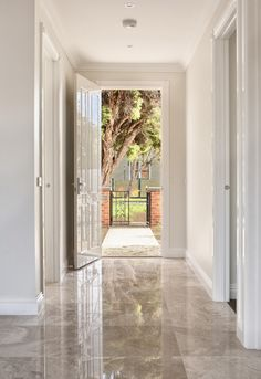High Gloss Tiles Laundry, Breakfast Nook Front Hallways Etc Boardered By  Dark Wood Panel And A Metal Strip ?