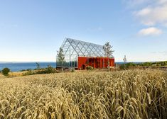 All photos by Ulf Celander via Dezeen By Sweden's glorious Lake Vättern, the familiar red barn and always striking greenhouse building forms have merged to create Uppgrenna Nature House, the...