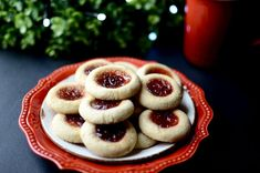 Holiday thumbprint cookies with red cherry, strawberry, or raspberry filling - recipe with how-to photos Confectioners Sugar Glaze, San Marzano Tomato Sauce, Cookie Buffet, Italian Almond Cookies, Vanilla Bean Frosting, Marinated Tomatoes, Pork Roast Recipes, Homemade Tomato Sauce, Roll Cookies