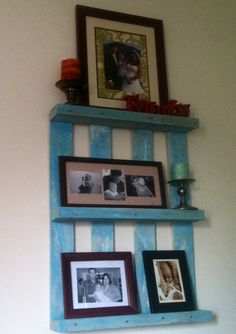Reclaimed pallet for pictures and nick knacks. Two holes in my rental wall instead of 6!