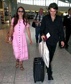 Pretty in pink: Keira Knightley and husband James Righton strolled through Heathrow airpor...
