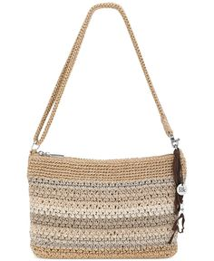 Three for the road. Casual crochet composes this versatile zip-top design from The Sak that goes from a shoulder bag to a crossbody to a clutch in just a click. Furnished with plenty of pockets, it ke