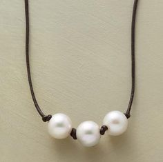 """Simply beautiful, refreshingly modern—a trio of pearls knotted together on a leather cord. Sterling silver clasp. Handmade in USA for Sundance. 17""""L."""
