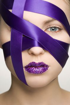 Purple ribbon for wrapping gifts...and she's gone and wrapped her face in it. :)
