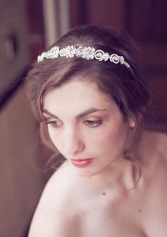 A glamorous crystal headpiece with floral designs from Daisy Day - perfect for a 1920s wedding! Click here for more pictures and info... #weddingideas