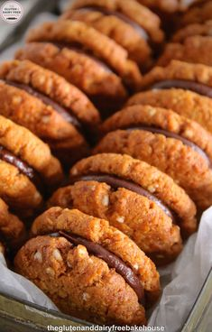 Kingston Biscuits. Once you've eaten one, it is very hard not to want to reach for another. For those of you who do not know what a Kingston is, they're two, sweet, crisp, coconut biscuits with a layer of chocolate ganache sandwiched between them.