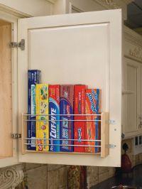 Cupboard rack for storing saran wrap, aluminum foil, etc.