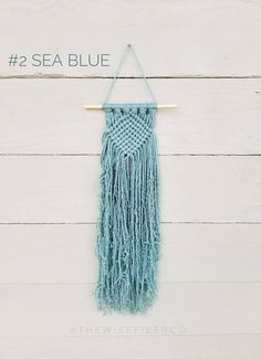 Mini macrame wall hanging in your choice of 10 different coastal / beach house themed colors: 1. Glacier 2. Sea Blue 3. Teal 4. Peacock 5. Mint 6. Medium Blue 7. Royal Blue 8. Country Blue 9. Denim 10. Navy These woven like wall hangings are reminiscent of friendship bracelets