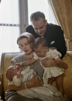Princess Grace is the only woman in history who can manage to look so serene as her two children freak out and misbehave in her arms!  Look at Caroline and baby Albert - they look miserable!