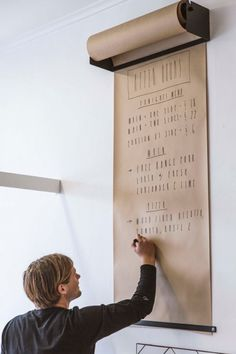 wall mounted paper roll dispenser for message center. Great idea for an ongoing grocery list.