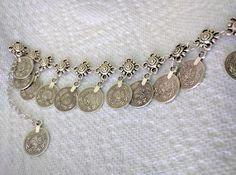 ankle bracelet with coins. can be found at carolspotteryandporcelain.com in the jewelry store for $ 24.95