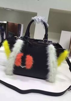 Fendi Mini 3Jours in Black Leather with mink-fur trim. See more fendi bags at http://www.luxtime.su/fendi-bags