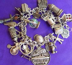 Atomic Ranch House: I would LOVE to have a vintage charm bracelet. I'd keep some of the originals and add some of my own! Vintage Charm Bracelet, Silver Charm Bracelet, Silver Charms, Silver Bracelets, Charm Jewelry, Beaded Jewelry, Jewelry Bracelets, Silver Jewelry, Vintage Jewelry