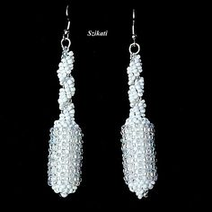 Beadwoven white seed bead earrings $35.00
