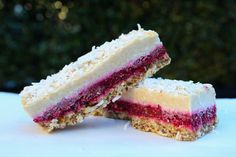 Next-Level Louise Slice. This wonderful recipe is by 'begoodorganics'. These slices are fresh, delicious and have such lovely textures; a slightly crunchy base, a soft raspberry jam layer, a creamy coconut topping and crunchy shredded coconut. Together, the raspberry and coconut are such special flavours.