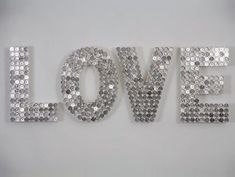 """Love by Artist Justine Smith.US Quarter dollars, sprayed wood. 120 x 41 x 9cm. 2007. HERE.Go to her site for several other money made pieces of art. Labeling as a DIY because you can recreate lots of words using different currencies. Ways to clean or give money """"patina"""" are all over the web."""