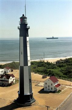 USS Theodore Roosevelt passes the historic Fort Story lighthouse in Virginia Beach, Va. What a scenic view!