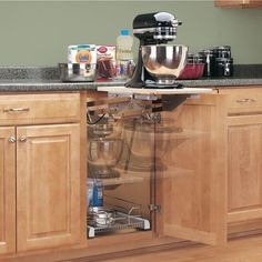 Install an appliance lift that goes right into the cabinet.