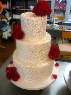 3-tier Cream wedding cake decorated with delicate gold twirls & red roses by Charly's Bakery, via Flickr