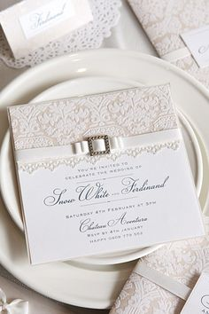 "Swoon-worthy invitations that are easy to create? Definitely a ""do!""With its white-on-white design, these invites featured on Polka Dot Bride are lovely for a wonderland wedding or for a bride with a classic sense of style. The flocked paper and buckle add a unique touch without being costly.GET THE STEP-BY-STEP INSTRUCTIONS ►Photo Credit: Elle from Christina Re"