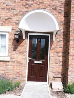 Lovely mahogany finish composite door with canopy