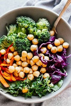 BROCCOLI AND CHICKPEA RAINBOW POWER BOWLS. 18 Vegetarian Bowls That Make Breakfast, Lunch and Dinner a Breeze #purewow #vegetable #salad #food #veggiebowl #vegetarianbowls #vegetarianlunches #vegetariandinners #chickpeas