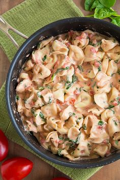 Creamy Spinach Tomato Tortellini - this was unbelievably delicious and so easy to make!! I'll make this again and again.