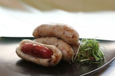 Dachang Bao Xiaochang (Small Sausage in Big Sausage); This snack takes its name from the wrapping of a glutinous rice sausage around a Taiwanese pork sausage, both of which are grilled. The sticky rice sausage is slit open and filled with peanut powder, cucumber, Chinese parsley (cilantro), pickled mustard greens, Chinese basil and, lastly, the smaller pork sausage. Sauces are sometimes added. Served hot, the delicious snack easily conquers one's taste buds.