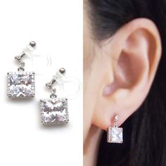 Sparkle filled dangle square cubic zirconia crystal invisible clip on earrings. They will look gorgeous with your wedding or any elegant outfit. These invisible clip on earrings are made from resin and comfortable to wear. You can wear them for straight 8 hours. And moreover, earring backs are clear, so they are look like pierced earrings. These magic like invisible clip on earrings are available at MiyabiGrace. 夾耳環, 夾式耳環, イヤリング, Non Pierced Earrings