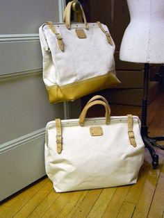 canvas mason bag with leather bottom.