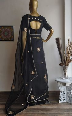 Featuring this beautiful Black saree in Organza base with hand embroidered gota patti bootis all over. It is paired with a Black Dupion blouse with Gota Patti Work on Front, back and sleeves.  ... www.labelkanupriya.com ... #organzasaree #designersaree #floral #designerblouse Sari Dress, Saree Blouse, Blouse Patterns, Blouse Designs, Gota Patti Saree, Organza Saree, Black Saree, Baby Girl Dresses, Sarees Online