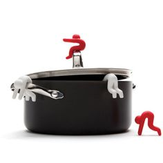 I love this #kitchen #gadget. It's a little man that hangs over the side of your pots to keep the lids vented.