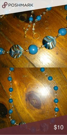 """Beautiful multibead necklace Handmade 19"""" necklace with beautiful turquoise, gold, clear, white, brown, and even a subtle streak of shimmer/glitter on the largest of the glass beads. Never worn. A great addition to any jewelry box for accessories and coordinating! Jewelry Necklaces"""