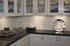 After+-+Butler+Pantry+subway+white+tile+glass+upper+cabinet+black+marble+counter+white+lower+cabinet.jpg 448×296 pixels