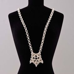 Byzxantine Weave Star Necklace attached to a 2 in 2 chain. $120.00, via Etsy.