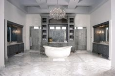 This luxurious #bathrpoomdesign by Design Homes & Development makes you the center of attention in your own bathroom.