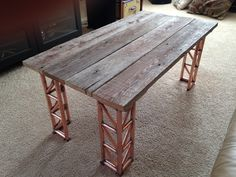 Coffee table using re-claimed oak bark siding for top. Legs made with brazed copper tubing re-claimed from older house.