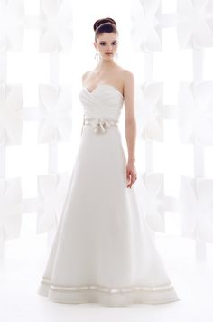 Gown 1708   2012 Fall Collection   Mikaella Bridal   Available Colours : Diamond (Shown Metallic Ribbon with Flower embellishment at waist also Organza skirt with Ribbon at hem)