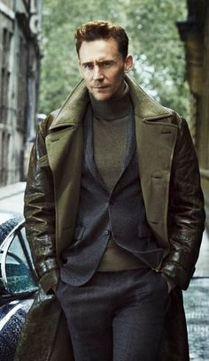Shop this look on Lookastic:  http://lookastic.com/men/looks/charcoal-dress-pants-olive-turtleneck-charcoal-blazer-olive-trenchcoat/6614  — Charcoal Wool Dress Pants  — Olive Turtleneck  — Charcoal Wool Blazer  — Olive Leather Trenchcoat