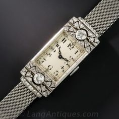 Expertly and and artfully hand fabricated in platinum in 1925-'30 France, the beautiful case and bracelet of this chic Art Deco bracelet watch houses the finest Swiss movement by the renowned Vacheron & Constatin of Geneve. The sleek rectangular dial is dressed up on each end with sparkling white diamond bow-tie motif. 5/8 inch wide, the lithe and supple mesh bracelet is adjustable to 8 1/2 inches and 5/8 inch wide.