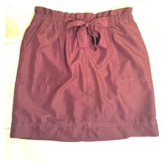 """Merona M Brown skirt Front Tie Merona M Brown skirt Front Tie. So cute!  Pockets!  Measures 15"""" across waist and 19"""" long.  Kinda reddish brown, but not so red That I would call it Marion. More brown than real true maroon. Merona Skirts Midi"""
