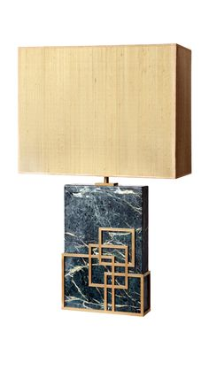Handmade table lamp with marble base and bronze decorative pattern with silk lampshade.