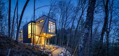 Cantilevered Holiday Home on a Cliff Overlooking a Lake in Canada