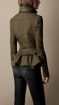 "Short wool coat. Love the back details from the ""skirted back"" to the zipper collar."